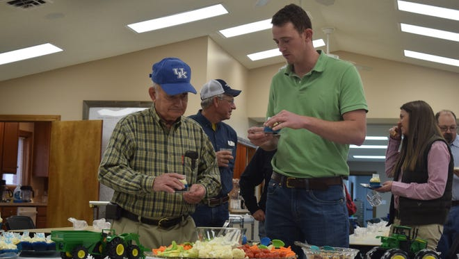 Rankin Powell and Brad Hagan enjoy refreshments during the open house. Powell retired as Union County's Agricultural Agent last fall.