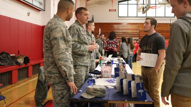 Port Clinton High School students hear about career opportunities with the U.S. military during the job fair on Thursday.