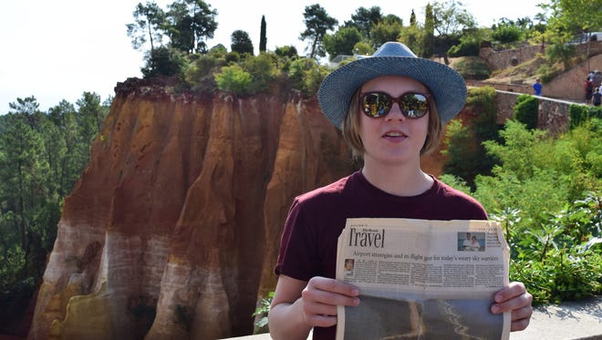 My son, Cory Gorczycki, in front of the amazingly red colored cliffs in the village of Roussillon.