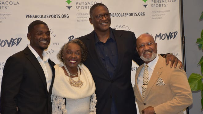 From left: Olympic sprint champion Justin Gatlin, his mother Jeanette, NBA Hall of Famer Dominique Wilkins and Gatlin's father Willie pose for photos Wednesday night at the 63rd annual Pensacola Sports Awards Banquet at New World Landing.