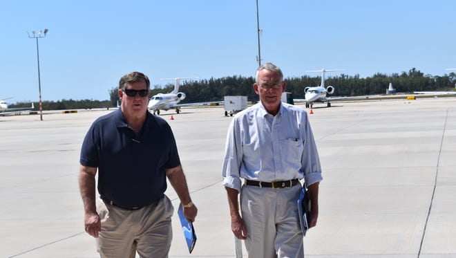 From left to right, congressmen Ken Calvert, R-California, and Francis Rooney, R-Naples walk from runway to Naples Municipal Airport terminal. They gave a press conference after taking an airport ride over the Everglades on March 18, 2017.