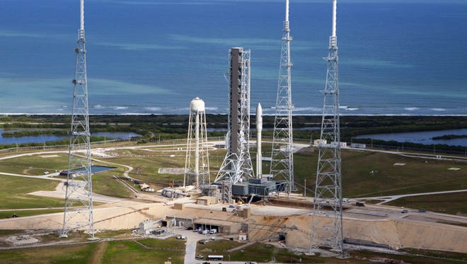 Artist concept of Orbital ATK's Next Generation Launch vehicle standing on pad 39B at Kennedy Space Center.