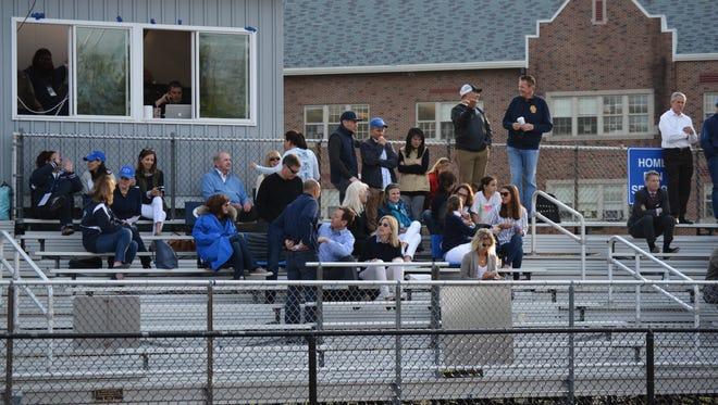 Parents watch a Bronxville lacrosse game.