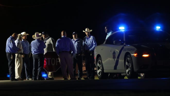 In this Monday, April 24, 2017 photo, Arkansas Department of Corrections officers man a road block at an Arkansas State Police Command post outside the Varner Unit as executions take place near Varner, Ark. Jack Jones and Marcel Williams received lethal injections on the same gurney Monday night, just about three hours apart. It was the first double execution in the United States since 2000.