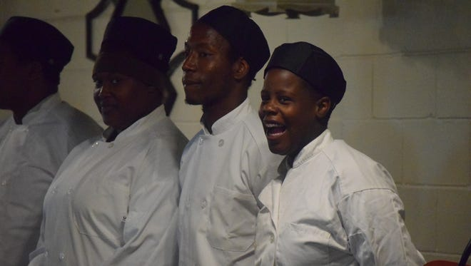 Several culinary students are introduced at the conclusion of the meeting.