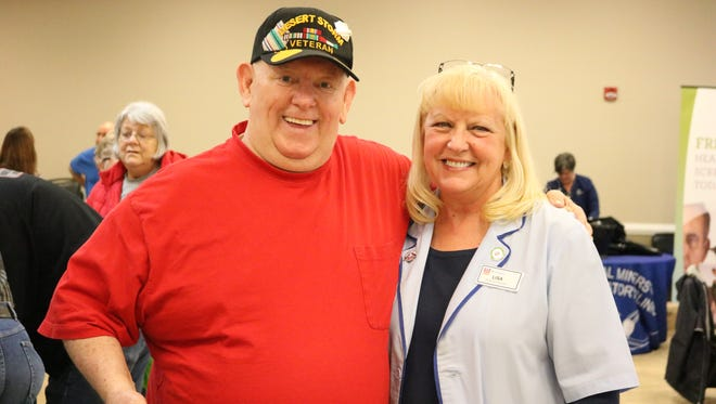 Local resident George Blakeley with Rite Aid Wellness Ambassador Lisa Attebery.