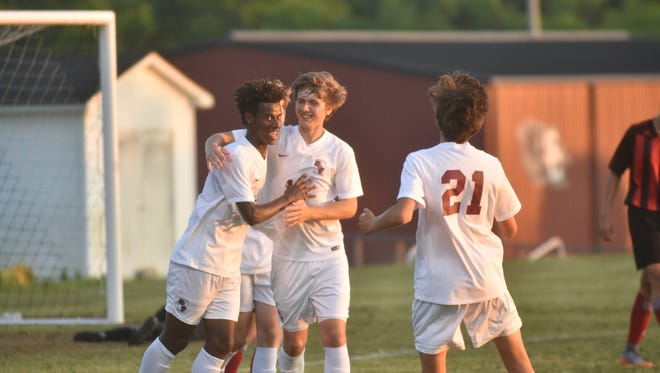 Atakelti Gebregzabher celebrates with his team after making his first of two goals for Station Camp on Tuesday night.