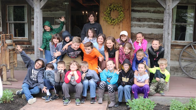 Third grade students from R.C. Waters Elementary School toured the historical Oak Harbor Log Cabin on Friday.