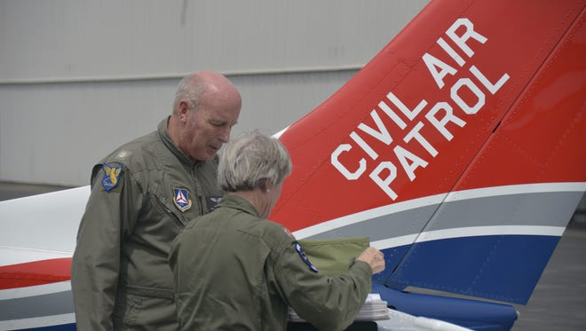 A submitted photo showing two members of the Civil Air  Patrol planning a search to find a missing airplane, which was carrying a married couple from Truckee to Petaluma, Calif.