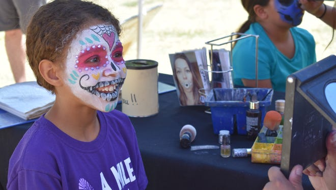 Aubrey Allen, a military child, gets a free face painting from No Limits Face Paint during Military Appreciation Day in Alameda Park Zoo.