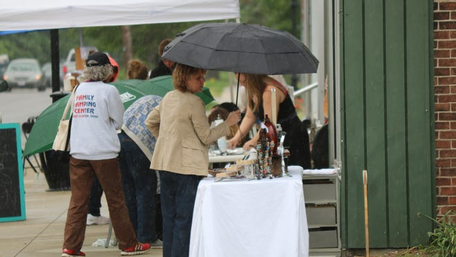 Off and on rain put a damper on the first 'Art Walk' of the year, but many locals braved the elements to check it out Thursday.