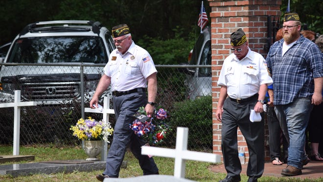 Duane Pickel leads a group of veterans at the VFW Cemetery during a Memorial Day service. The VFW is honoring local first responders on Jan. 25.