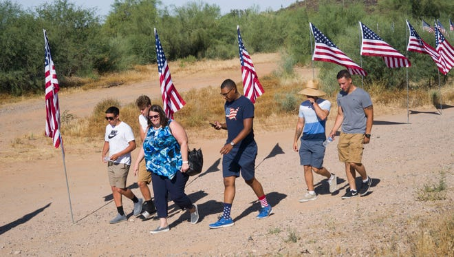 Veterans and their families honored fallen veterans on Memorial Day at the National Memorial Cemetery of Arizona on May 29, 2017, in Phoenix. Hundreds showed up to pay their respects to members of the military who have died serving the United States.