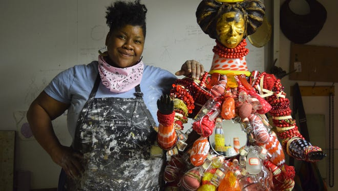 Visual and performance artist Vanessa German from the Pittsburgh neighborhood of Homewood was invited to participate in the WheatonArts art making community as part  of the 'Emanation 2017' residency and exhibition project. Here she is in her studio at WheatonArts with  one of her power figures.