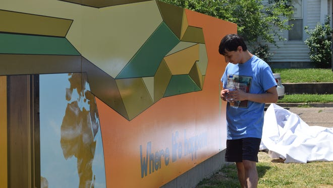 Josiah Blasser admires the mural he designed at East End Park.