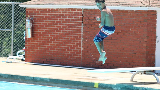 Rishaun Dejarnett jumps in the pool during a day trip with his friends.