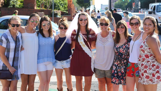 Bride-to-be Brittanie Barker and her bridal party celebrated her wedding in Nashville at the Country Music Association Fest.