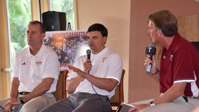 Troy Trojans football coach Neal Brown (center) discusses the football program's breakthrough season with Troy men's basketball coach Phil Cunningham (left) and Troy broadcast director Barry McKnight during the Trojan Tour 2017 stop Thursday at Scenic Hills Country Club.