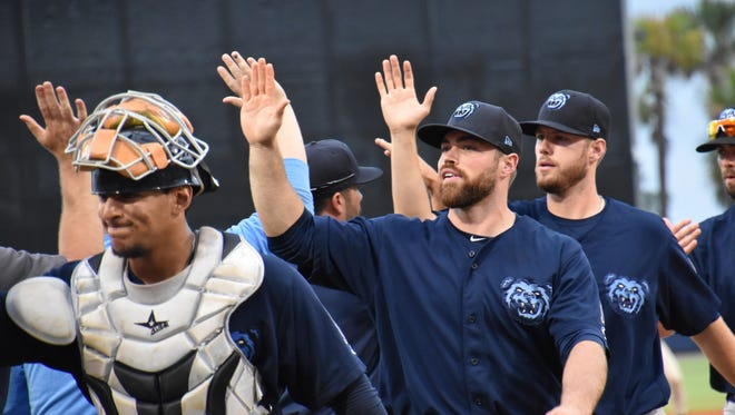 Pensacola's Wade Wass, shown congratulating fellow Mobile BayBears' teammates, played last year in Mobile and was named to the Southern League All-Star team that visited Pensacola. The BayBears approved sale and likely move from Mobile has moved closer to reality.