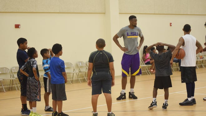 LSU basketball player Aaron Epps  ,who formerly played for Tioga High School, helps out at a basketball clinic held Saturday at Zion Hill Church Family in Pineville.