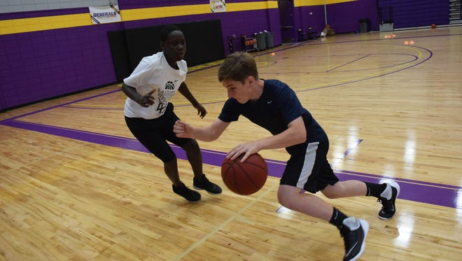 Patrick Simmons (left) and Jack Price run through offensive and defensive drills at the Cordaro Basketball 2017 Youth Camp held Wednesday, July 12, 2017 at LSUA. The camp is hosted by Larry Cordaro, head coach of the LSUA men's basketball team. In the camp, students are taught the fundamentals of basketball such as dribbling, passing, shooting and defense stance.