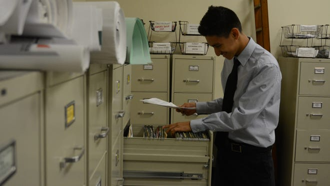 Indio High School senior Cristian Cabrera files paper at Chandi Group USA. Cabrera is a migrant student and wants to become an accountant after working with Chandi Group.