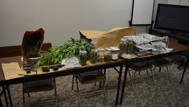 The Juneau County Sheriff's Department found about 10 pounds of marijuana, cocaine, hallucinogenic mushrooms, two handguns and other drug contraband while searching a Juneau County home Thursday.