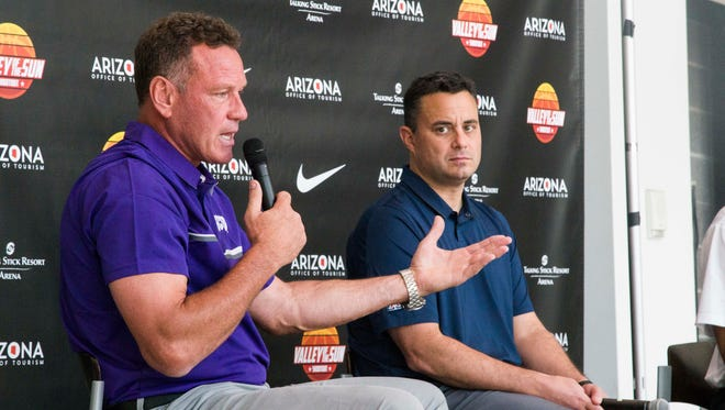 Grand Canyon men's basketball coach Dan Majerle and Arizona men's basketball coach Sean Miller answer questions at a news conference at Talking Stick Resort Arena in Phoenix.