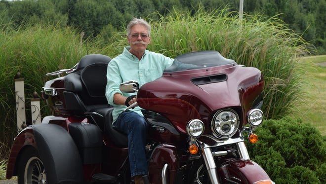 Local sculptor Wyatt Gragg is shown on his Harley Davidson.  Gragg is being commissioned for an interactive life size sculpture that honors Bruce Heilman and WWII veterans. Heilman is the national spokesperson for The Greatest Generation Foundation. The sculpture will be located on the Oldham County History Center campus