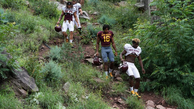 Arizona State football players make their way to the practice firld at Camp Tontozona on Monday, Jul. 31, 2017 in Kohls Ranch, Ariz.