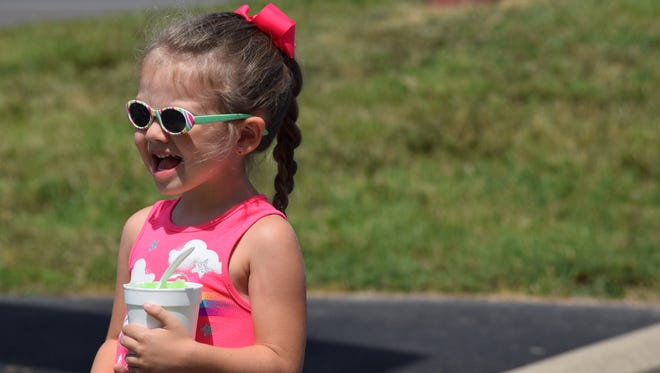 Ainsley Wolfe smiles with her snow cone at the event.