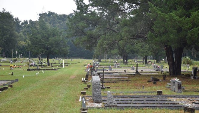 Small white flags at the Milton Historic Cemetery on Thursday, Aug. 3, 2017, identify newly marked sections at the cemetery as part of the city's organization efforts.