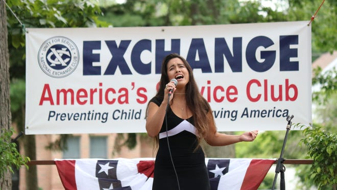"""Zuriana Antonio, of Port Clinton, performs """"I Will Always Love You"""" by Whitney Houston in Fremont's Got Talent at Birchard Park on Sunday, where she won third place."""