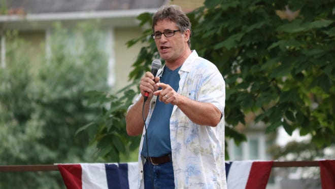 Dave Scagnetti performs 'Lonely Teardrops' by Jackie Wilson in Fremont's Got Talent at Birchard Park on Sunday, where he won first place.