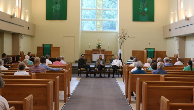 More than 50 gather in Trinity Presbyterian Church to question a panel of two Presbyterians and one Muslim at an interfaith event Sunday.