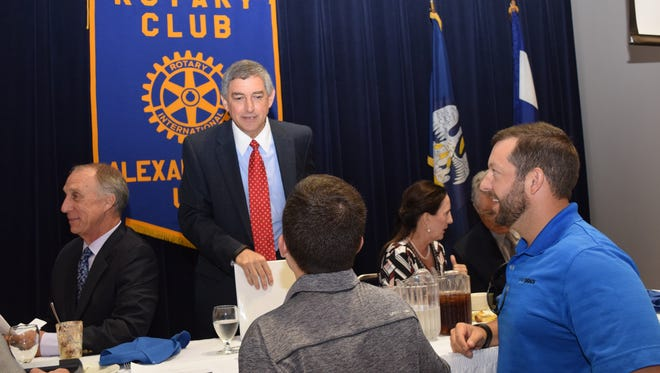 Jay Dardenne (back, right), commissioner of the Division of Administration, was the guest speaker at the weekly luncheon of the Rotary Club of Alexandria.