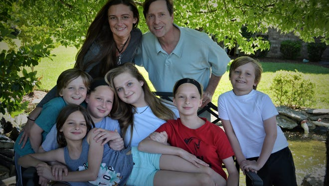 Catherine Neal, back left, is battling a stage IV glioblastoma multiforme tumor. Family members and friends are hosting a fundraiser to help the mother of six and her husband, Hicks Neal.