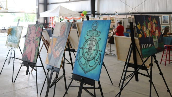 """""""Canvas Madness"""" features 15 local artists, whose paintings are pictured here, battling it out live with brushes during the annual 'Appetite for the Arts' event."""
