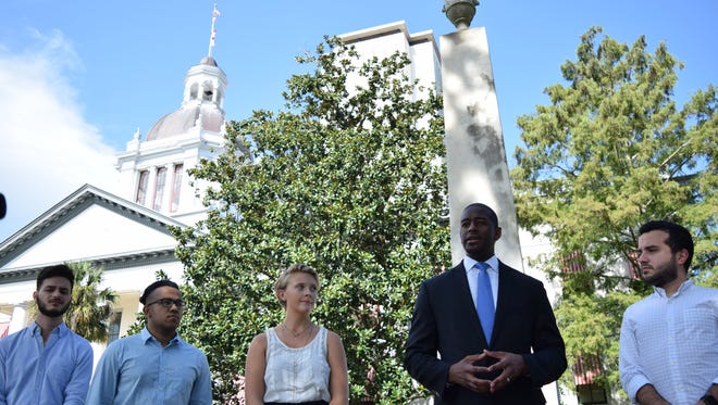 Mayor Andrew Gillum calls for the removal of Confederate monuments while standing in front of one on the Old Capitol lawn on Saturday.