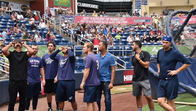 Several of the Blue Wahoos players, arrived early Monday before their game to catch glimpse of solar eclipse.