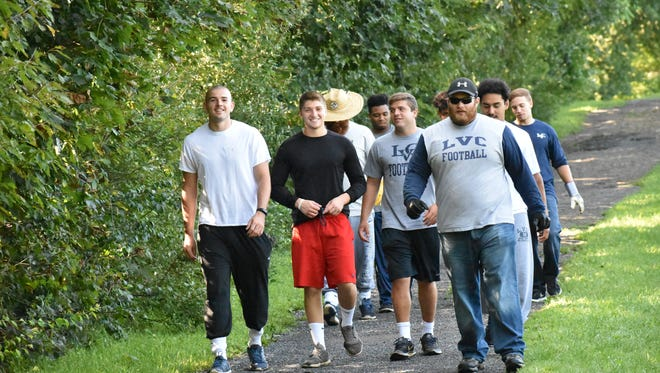 Members of the Lebanon Valley College football team took part in a community service clean-up project at Stoever's Dam Park on Sunday.