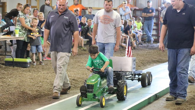 Jimmy Meggitt, 7, of Vickery, won first place at the Kiddie Tractor Pedal Pull on Saturday after pulling 55 pounds over 27 feet.