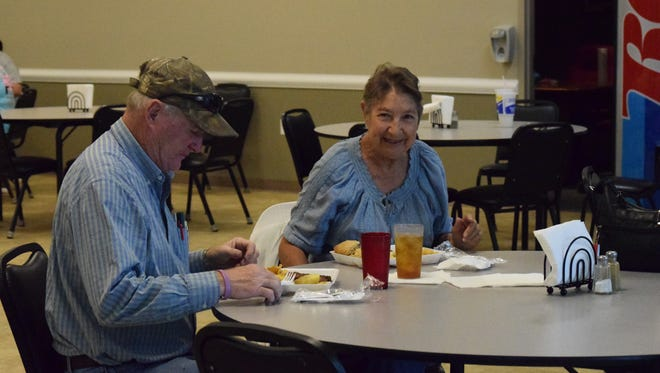 Larry and Vicki Bickett enjoy a meal together at the senior center during the final feast event.