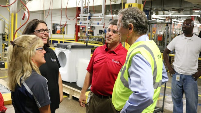 Sen. Sherrod Brown, right, speaks with two master trainers at Whirlpool, Laura Bannister and Lacy Newsom, during his tour of the company's plant in Clyde on Tuesday.
