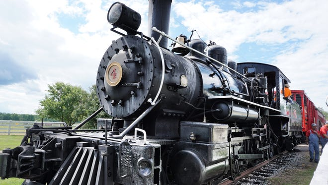 A 1916 locomotive takes visitors from Laona to Camp 5, an old logging camp turned museum in Forest County.