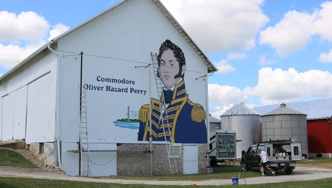 Scott Hagan, also known as 'The Barn Artist,' is finishing up work on Ottawa County's historical barn mural featuring Commodore Oliver Hazard Perry.