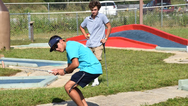 Ty Aulger and Nicholas Dimitroff have some fun at Goofy Golf at a reception Sunday prior to leaving for Pebble Beach, California where they play in this week's PGA Tour Champions Pure Insurance Classic and represent First Tee of Northwest Florida.