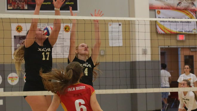 Xavier Prep's Maria Callahan (No. 17, left) is a captain and imposing force at the net for the Saints.