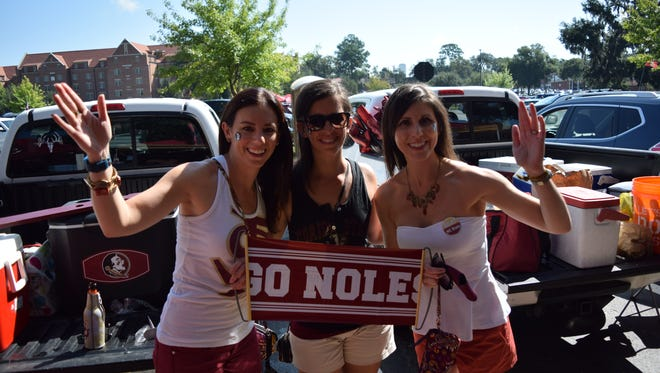Megan Rhodaback, Ashley Kurit and Brittany Dambly, sisters and Florida State alumni, tailgate before the NC State game on Sept. 23.