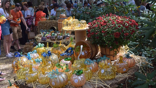 The glass pumpkin patch at the WheatonArts  Festival of Fine Craft attracts a crowd every year. Photo/Jodi Streahle